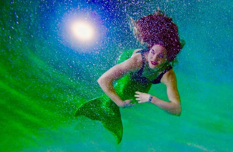 Mermaids swimming-